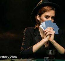 woman bluffing playing poker
